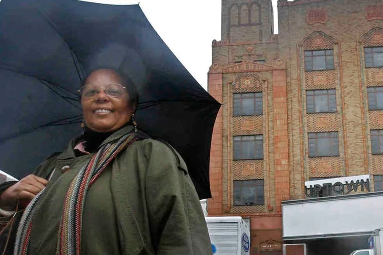 In this file photograph, taken on April 4, 2011, Linda Richardson stands in front of the Uptown Theater on North Broad Street. She died Monday, Nov. 2, 2020 at age 73.