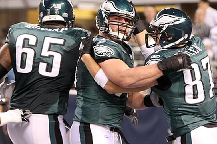 The Eagles' offensive line played a key role in the final minutes of Sunday's win. (Steven M. Falk/Staff Photographer)