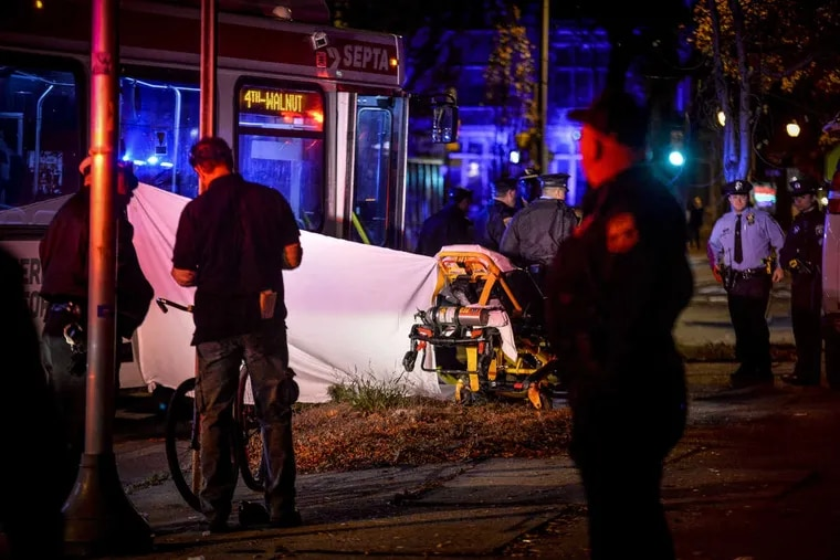 Emergency personnel investigate the scene of a fatal accident after a SEPTA bus hit a pedestrian around 5 p.m. Monday near the corner of Chestnut Street and 23rd Street in Center City on Monday.