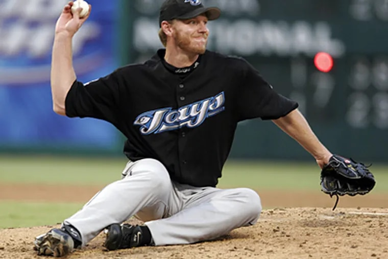The Phillies have the flexibility to add Roy Halladay if they choose to trade for the Toronto Blue Jays ace. (AP Photo/David Pellerin)