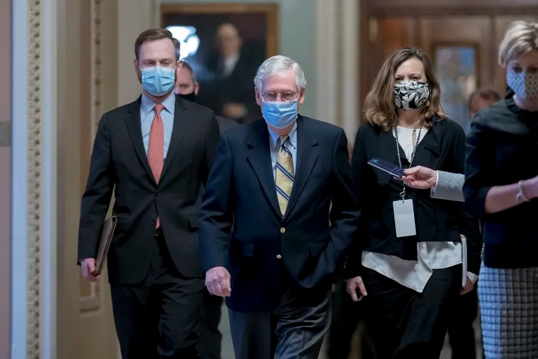 Senate Minority Leader Mitch McConnell (R., Ky.) leaves the chamber after the Senate voted not guilty in the impeachment trial of former President Donald Trump on the charge of inciting the Jan. 6 attack on the U.S. Capitol.