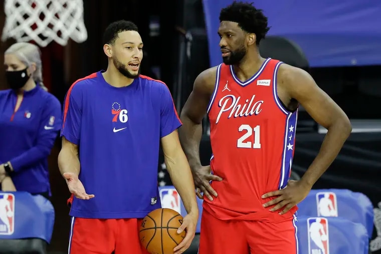 Sixers guard Ben Simmons and center Joel Embiid talk before the start of the second half against the Boston Celtics on Friday, January 22, 2021 in Philadelphia.