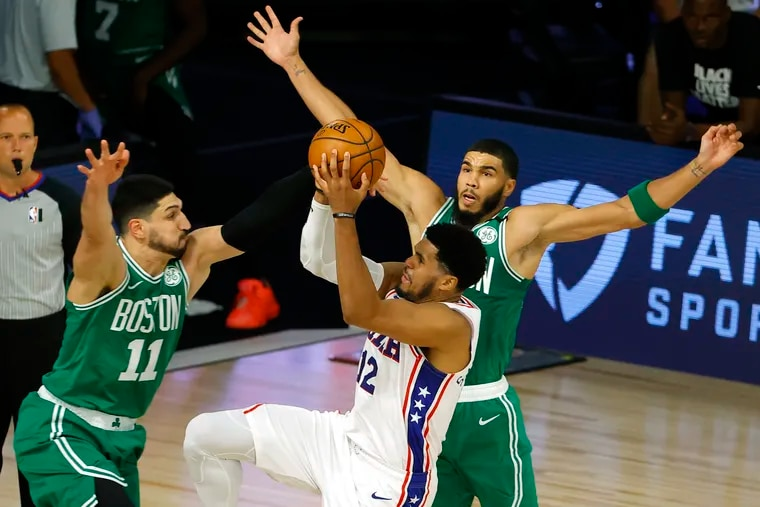 Tobias Harris drives against Jayson Tatum (right) and Enes Kanter in the first half.