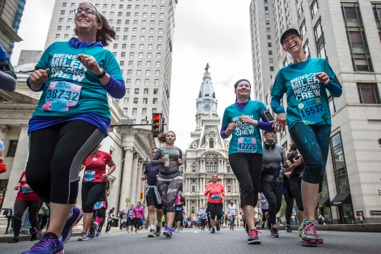 File photo of runners as they make their way down Broad Street past City Hall.