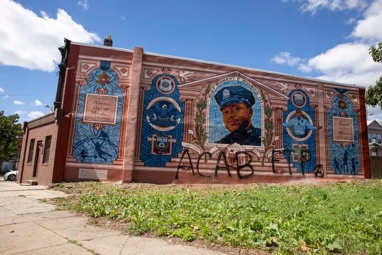 A mural honoring slain officer Sergeant Robert Wilson III by artist David McShane was vandalized in West Philadelphia Sunday.