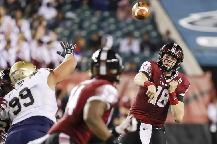 Temple quarterback Frank Nutile passes to tight end Kenny Yeboah during the fourth quarter Thursday.