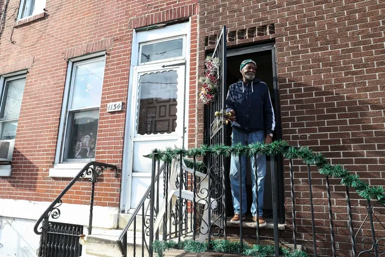 Eddie Burton laughs after Craig Robbins, Philadelphia Regional Director of the For Our Future Action Fund, spoke with him in the Point Breeze neighborhood in Philadelphia, Pennsylvania on Wednesday, December 11, 2019. The For Our Future Action Fund promotes progressive values and causes. While out door knocking, Robbins asked registered voters what issues they cared about most.