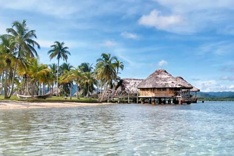 A thatched hut perches over the water at Isla Yandup, the size of a football field and reached by wooden gangplank. The huts are $95 a night. (Marcela Mikkola)