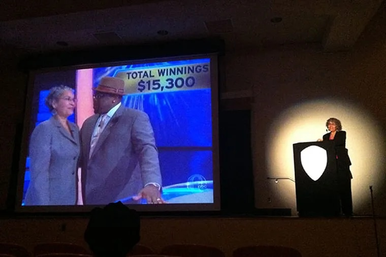 """Hazel Spears (right), an assistant professor of psychology at Cheyney University, watches herself as she appears on the game show """"Who Wants to be a Millionaire?"""" The school held a viewing party in a college auditorium Wednesday, April 30, 2014."""