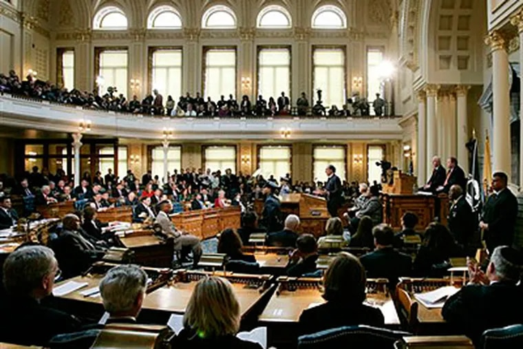 New Jersey Gov. Jon S. Corzine, standing at podium at center, delivers his budget address to a joint session of the legislature early this month. (AP Photo/Mel Evans)