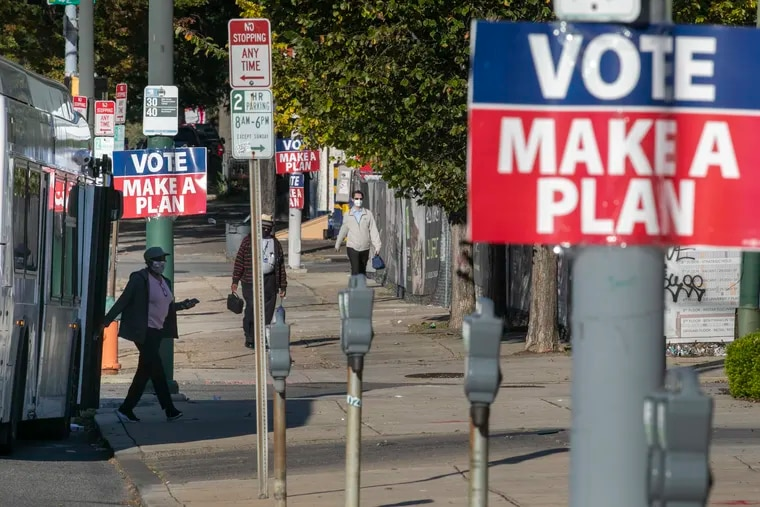 """""""VOTE MAKE A PLAN"""" signs along Market St near 42nd St. in Philadelphia as seen on Friday morning October 9, 2020. The signs are reminders to vote this coming presidential election."""