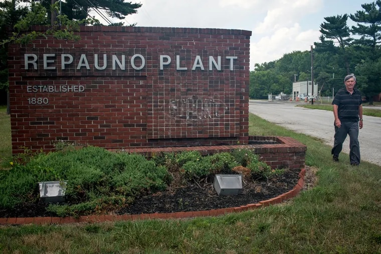 Greenwich Mayor George Shivery walks past the DuPont Repauno Plant in the township.