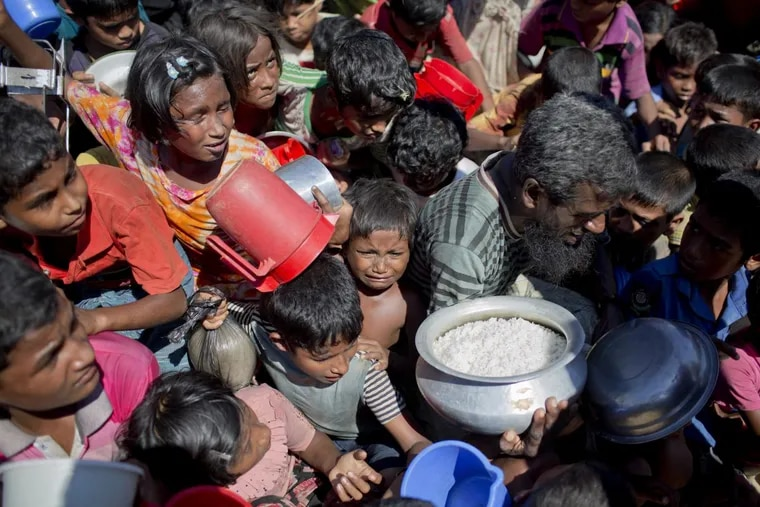 A Rohingya Muslim child cries as she and others wait to receive food distributed from a Turkish aid agency at the Thaingkhali refugee camp in Ukhiya, Bangladesh on Nov. 14.
