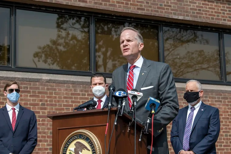 U.S. Attorney William M. McSwain, center, speaks about the public safety crisis in Philadelphia during a news conference outside the federal courthouse in Philadelphia on Monday, Sept. 14, 2020.