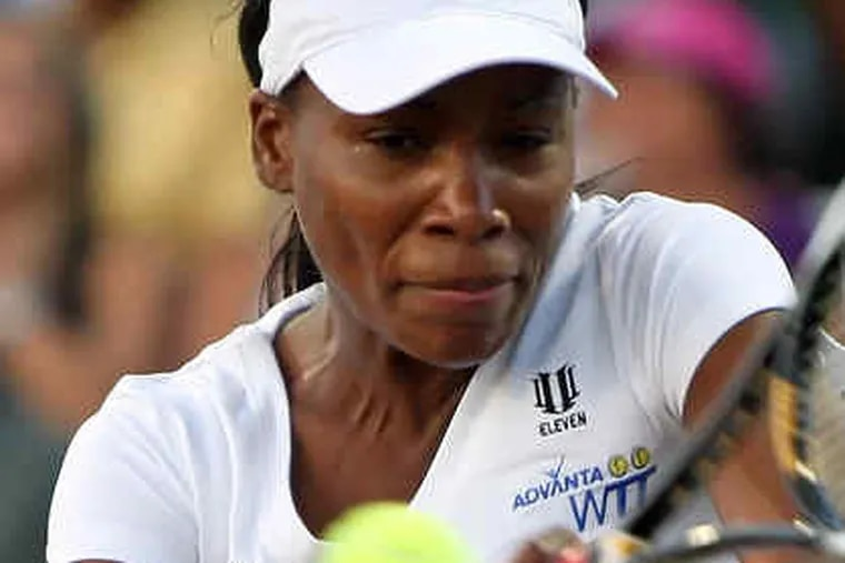 The Freedoms' Venus Williams returns a backhand to Angela Haynes in singles action. Williams, not at her best, lost, 5-1.