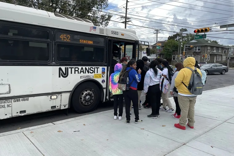 Students from Camden High board a NJ Transit bus after school on Wednesday, Sept. 22, 2021. Because of a severe school bus driver shortage, the district has provided bus passes for students to use public transportation.