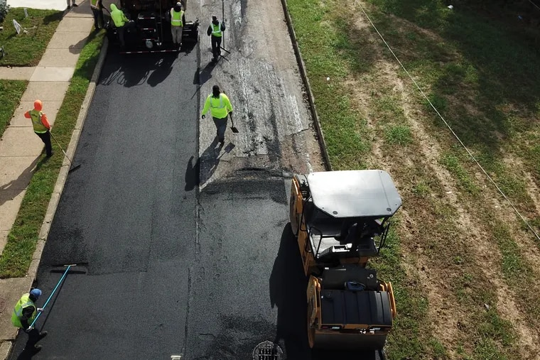 The city's street paving crews lay down a new surface on Benton Street near Bustleton Avenue in October. A new Philadelphia map lets residents track street-paving progress.
