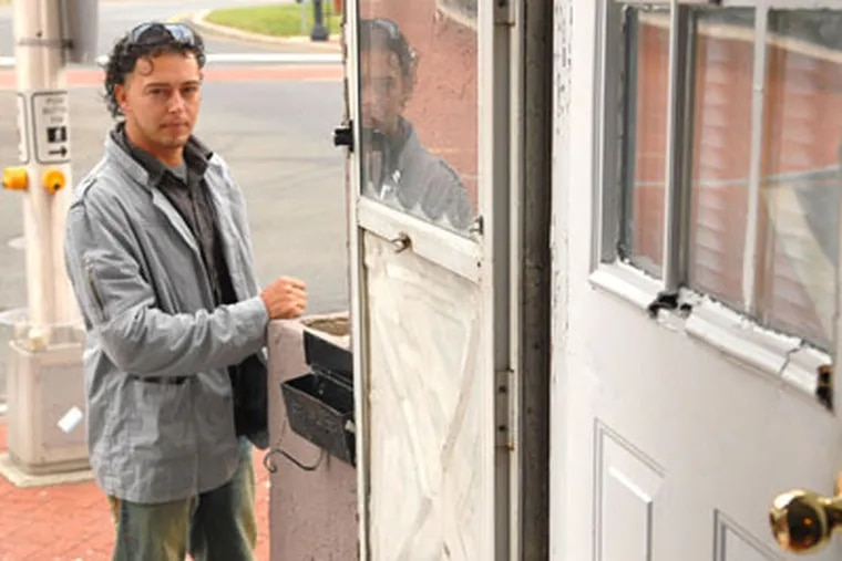 """""""I can't continue here,"""" Francisco """"Frank"""" Santos, at his Trenton apartment, said before returning to Brazil. (Peter Tobia / Staff Photographer)"""