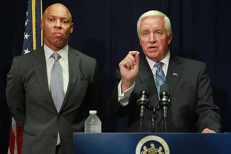 Gov. Corbett, right, speaks of advancing $265 million to the Philadelphia schools while Superintendent William Hite Jr, left, stands by ready to answer questions.