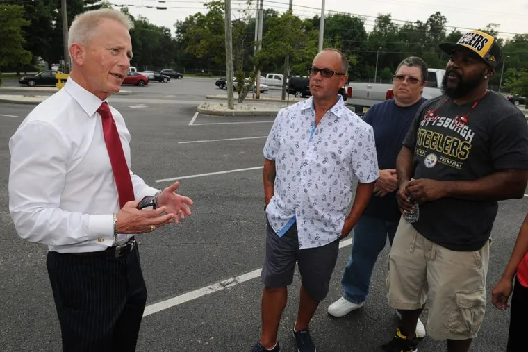 New Jersey Senator Jeff Van Drew (left) talking to General Mills workers about Vineland plant closing earlier this year. (RAYMOND HOLMAN JR / For the Inquirer )