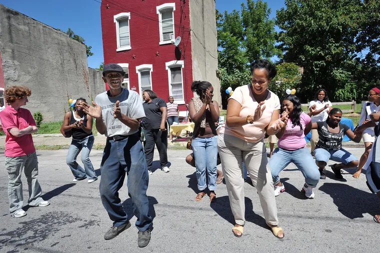 Vaux Roberts High School in Philadelphia threw a block party for the community, and they were dancing in the streets. In the front of the line are Larry Brooks(left), community volunteer and Ruth Birchett, of the School Advisory Council.
