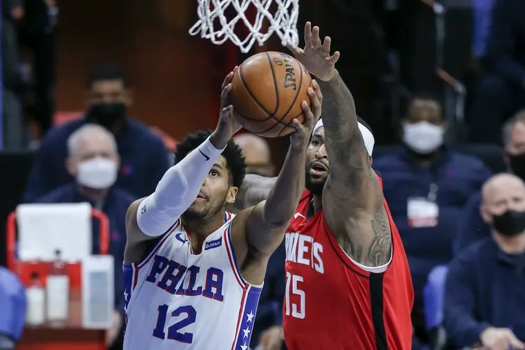 Tobias Harris drives to the basket in front of Houston's DeMarcus Cousins during the first quarter.