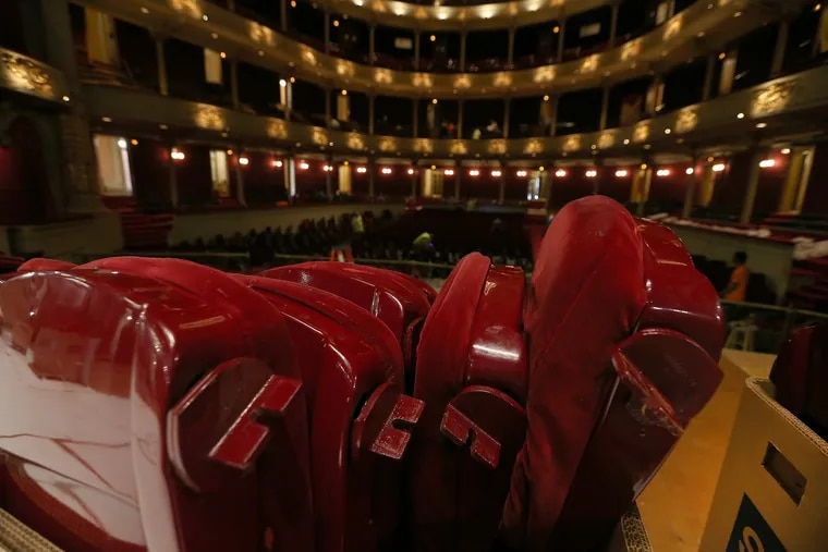 Old seats sit in boxes as they are removed from the Academy of Music in Philadelphia, PA on July 10, 2018.