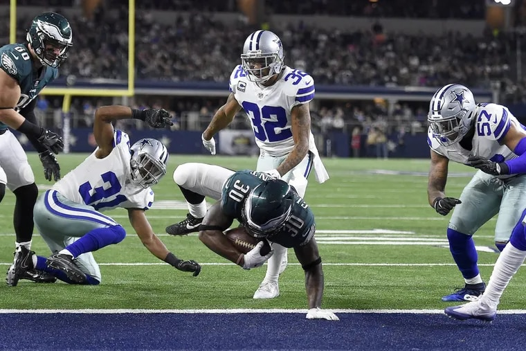 The Cowboys, shown here watching Corey Clement score a touchdown on Sunday, are a slight home underdog to the Chargers.