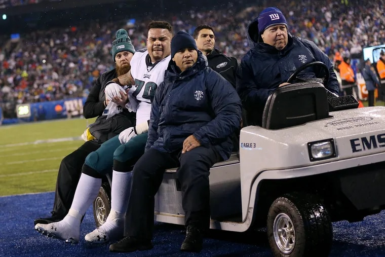 Eagles guard Brandon Brooks  is carted off in the second quarter of the game against the New York Giants.