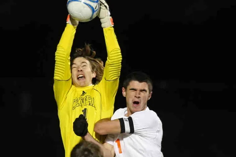 Hunterdon Central goalie Jake Schenck tries to keep the ball away from Cherokee's Dave Schlatter during the Chiefs' state championship win. Schlatter scored the game's only goal.