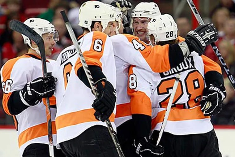 The Flyers celebrate Jeff Carter's second goal of the game in the second period. (Gerry Broome/AP)