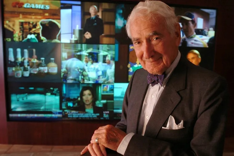 Ralph Roberts poses in front of a wall of 12 television monitors in the lobby of Comcast  executive offices on the 35th floor of 1500 Market Street.