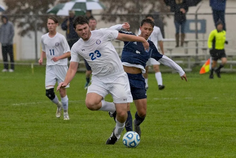 Washington Township's Will McCusker and Shawnee's Devin Ribeiro battle for the ball during Tuesday's S.J. 4 semifinals.