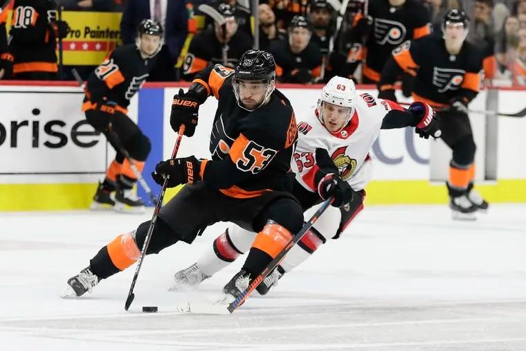 Flyers defenseman Shayne Gostisbehere skates past Ottawa Senators right winger Tyler Ennis last season. Gostisbehere will battle for a spot in the Flyers' defensive rotation this season.