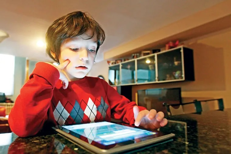 Jacob Weisgold, a kindergartner at St. Peter's School, started playing Words With Friends, a digital adaptation of Scrabble, when he was 5.  (Michael Bryant/Staff Photographer)
