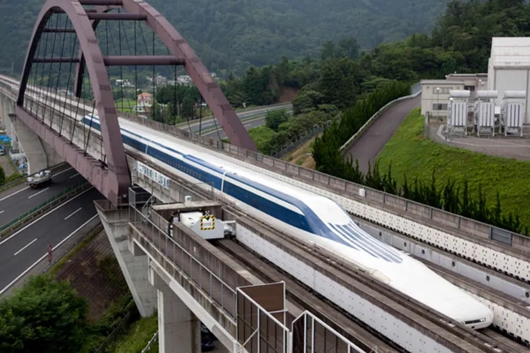 A magnetically levitated train crossing a bridge outside of Tokyo. (Northeast Maglev and Central Japan Railway Co.)