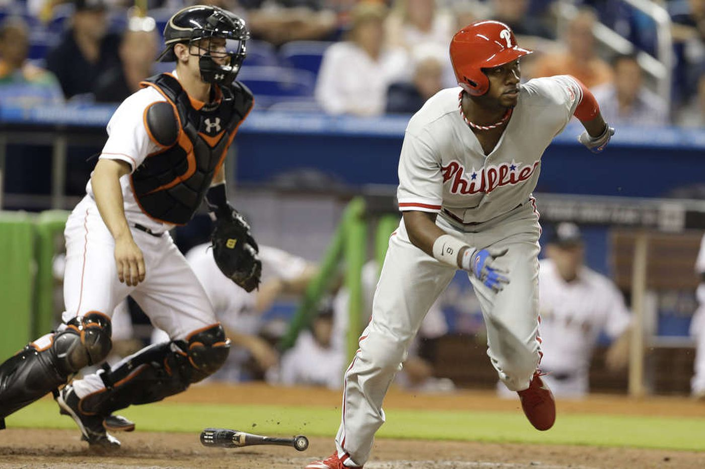 Phillies batter Marlins, but aching Utley sits out