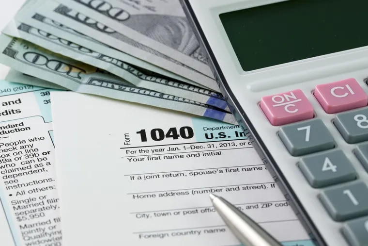 Filling out income tax forms (Dreamstime/TNS)
