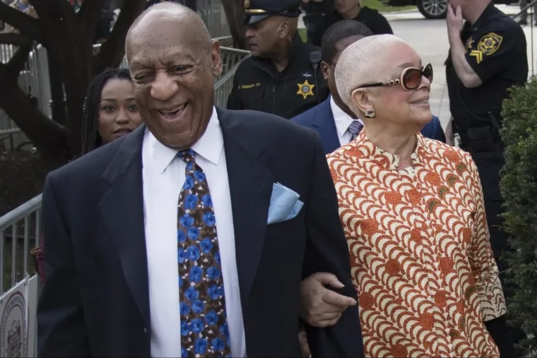 Bill Cosby, left, smiles as he arrives with his wife, Camille, for his sexual assault trial on Tuesday, April 24, 2018, at the Montgomery County Courthouse in Norristown, Pa.