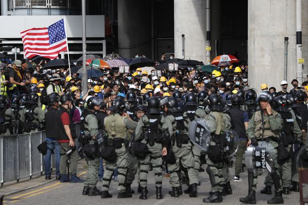 Hong Kong police fire tear gas, clear protesters by force