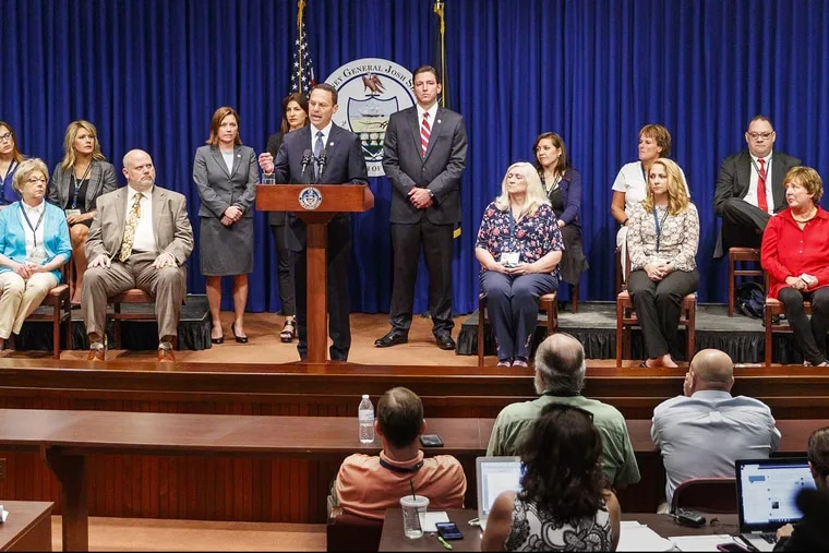 Pennsylvania Attorney General Josh Shapiro, center, speaks on the findings of the grand jury report on Catholic clergy sexual abuse. The report recommends changing the law to allow older victims to sue. (Michael Bryant/Philadelphia Inquirer/TNS)