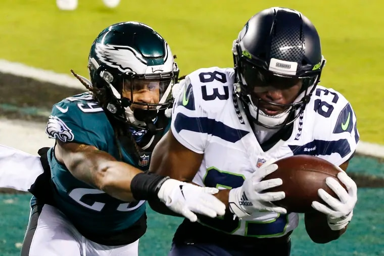 Seattle Seahawks wide receiver David Moore catching a touchdown pass while defended by Eagles cornerback Avonte Maddox last season.
