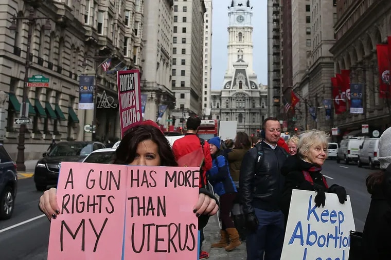 Gabby Richards (left) of Center City makes a statement at Broad and Locust in November.