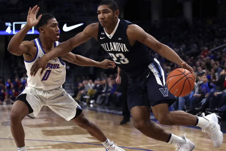 Villanova's Jermaine Samuels, right, driving against DePaul's Justin Roberts during the first half Wednesday.