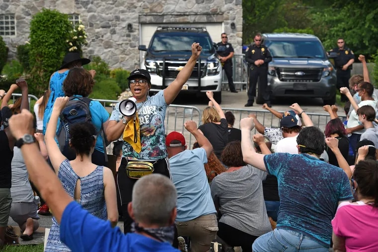 Rae Dean of Norristown leads protesters outside the Plymouth Meeting home of Montgomery County Commissioner Joe Gale June 7, 2020, calling for him to resign after he called Black Lives Matter a hate group.