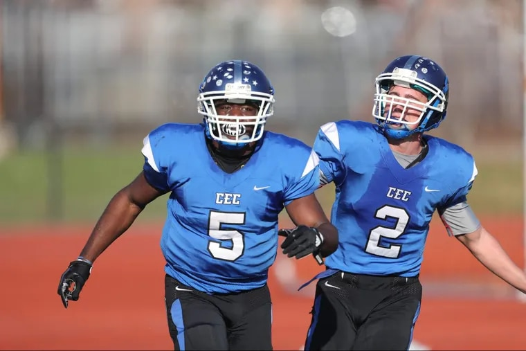 Patrick Garwo (5) and Chuck Layton (2) celebrate one of Garwo's three touchdowns in last Saturday's 34-17 victory over Palisades.