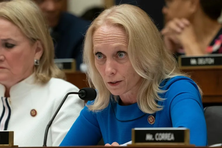 Rep. Mary Gay Scanlon, D-Pa., right, on Capitol Hill.