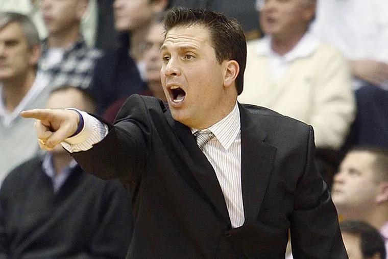 Billy Lange is the new St. Joe's coach.