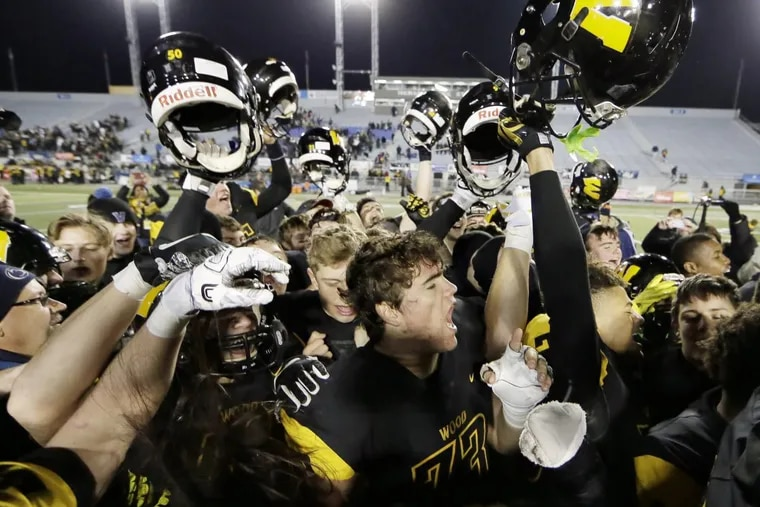 Archbishop Wood players celebrate after the team won the PIAA Class 5A state football championship Friday night.