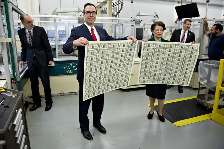 Treasury Secretary Steven Mnuchin and Small Business Administration head Jovita Carranza at the U.S. Bureau of Engraving and Printing in 2017. The new stimulus bill now forgives up to eight months of principal and interest payments on Section 7(a) and 504 Microloans from the SBA.